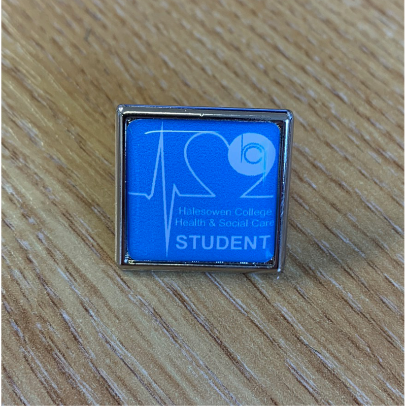 21mm Resin Pin Badge with Health & Social Care logo.